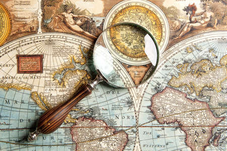 glass globe: Magnifying glass and ancient old map
