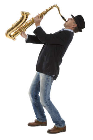 young musician: Full length portrait of a man playing on saxophone isolated on background