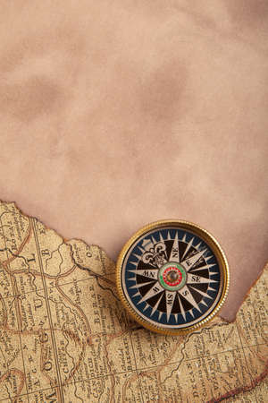 Old compass on vintage map 1687