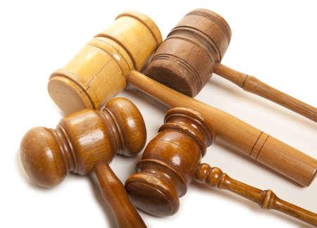 Set old wooden judges gavel isolated on white  photo
