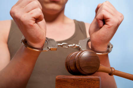 The arrest of the offender in the courtroom Stock Photo - 22278862
