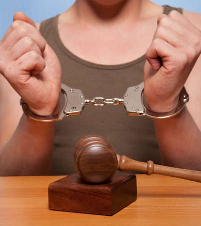 The arrest of the offender in the courtroom Stock Photo - 22341607