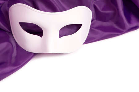White theatrical mask and silk fabric on a white background  photo