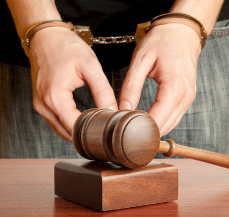 offender: The arrest of the offender in the courtroom Stock Photo