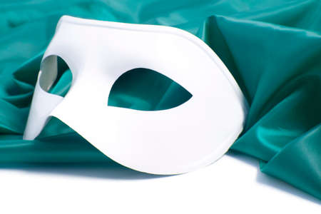 White theatrical mask and silk fabric isolated a white background photo