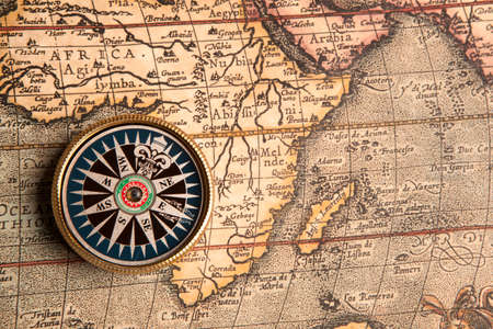 Old compass on vintage retro map 1687  photo