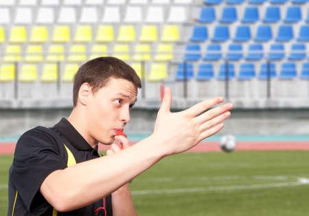 Male referee against the football stadium photo
