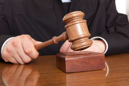 Judge. Referee hammer and a man in judicial robes Stock Photo