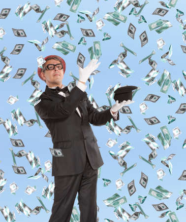 Businessman and flying dollar banknotes against blue sky photo