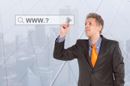 address bar: Businessman touching web browser address bar with www sign