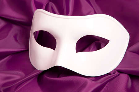 canvass: White theatrical mask and silk fabric  Stock Photo