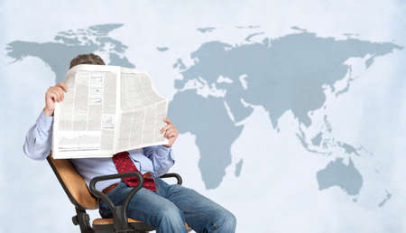 A businessman stockbroker reads the finance newspaper photo