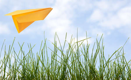 Yellow paper plane in the sky  Stock Photo