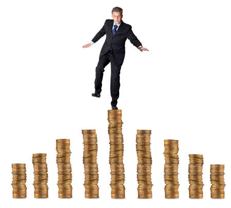 imbalance: Financial concept. businessman standing on the coins