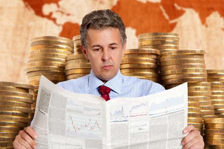 stockbroker: A businessman stockbroker reads the finance newspaper Stock Photo