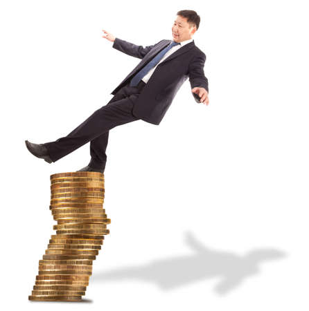 unstable: Financial and crisis concept. Asian businessman standing on the unstable coins