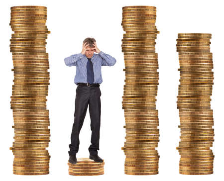 penury: Financial and crisis concept. Businessman standing on the unstable coins  Stock Photo