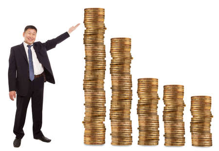 Asian businessman standing next to gold coins  photo