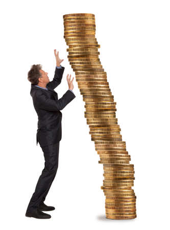 Businessman and stack of golden coins