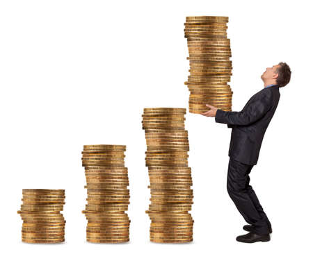 Businessman holding a stack of golden coins Stock Photo - 25101057