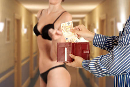 Prostitution concept. Man is paying for sex in euro banknotes Stock Photo