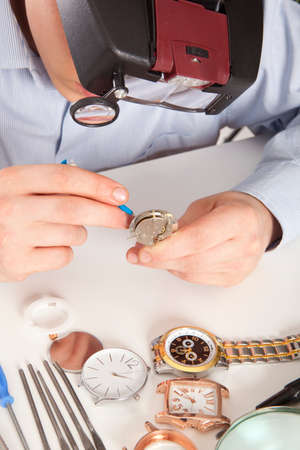 Watchmaker. Watch repair craftsman repairing watch  photo