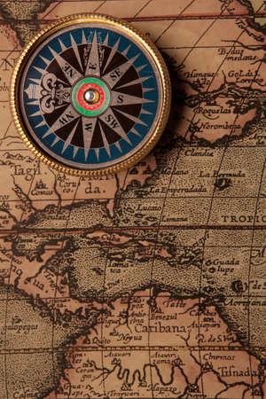 bygone: Old compass on vintage retro map 1687