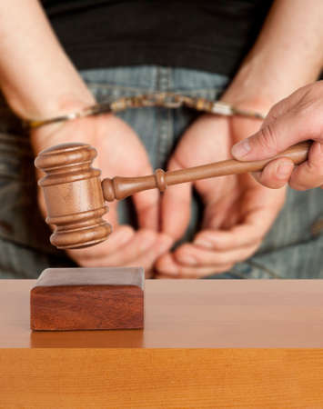 detain: The arrest of the offender in the courtroom Stock Photo