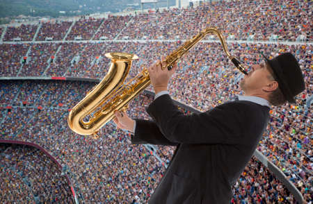 Fervent fans of football team play the saxophone photo