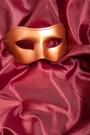 canvass: Golden carnival mask on red satin background  Stock Photo