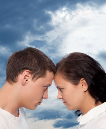 Young couple quarreling against a dramatic sky photo