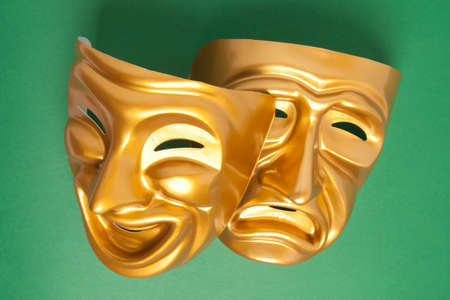 histrionics: Comedy and Tragedy theatrical mask on a green background