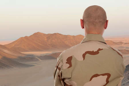 Soldier amid the mountains of Afghanistan photo