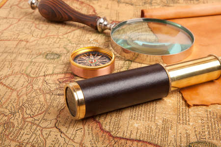 optical instrument: Vintage brass telescope on old antique map