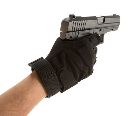finger on trigger: Mans hand holding a pointing gun with a finger on the trigger