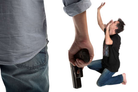 grabbing at the back: Man in a jeans holding a gun isolated on white
