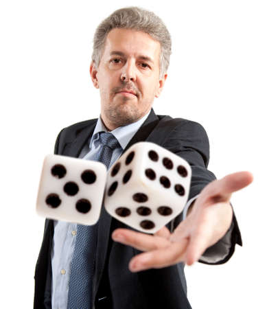 Man in a suit playing dice isolated Stock Photo