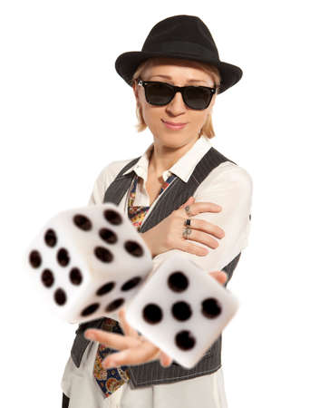 Blonde Woman in a hat playing dice isolated Stock Photo