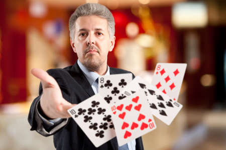 bluff: Bluff, Handsome man playing with poker cards