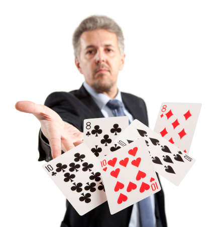 bluff: Bluff, Man playing with poker cards Stock Photo