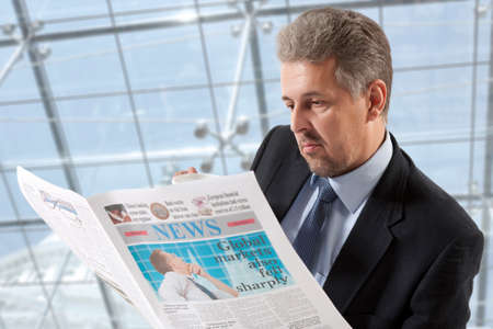 Businessman reading a newspaper, office backgrounds Stock Photo