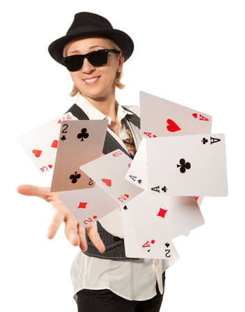 Bluff, happy woman in cap playing with poker cards photo