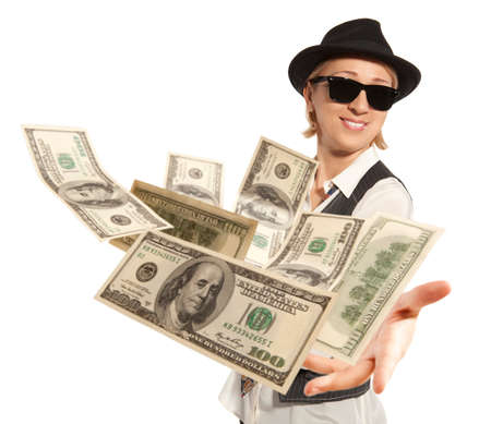 good fortune: Handsome adult business woman in cap throwing dollar isolated on background
