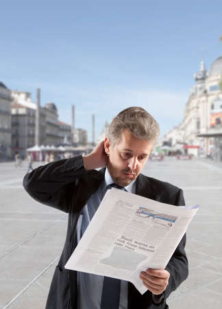 inform: Businessman reading a newspaper, office backgrounds Stock Photo
