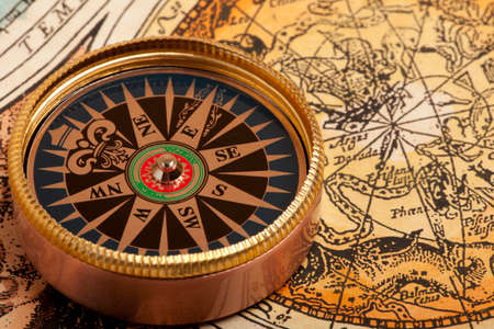 charred: Old compass on vintage retro map