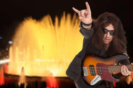 bassist: Bassist plays at a live concert