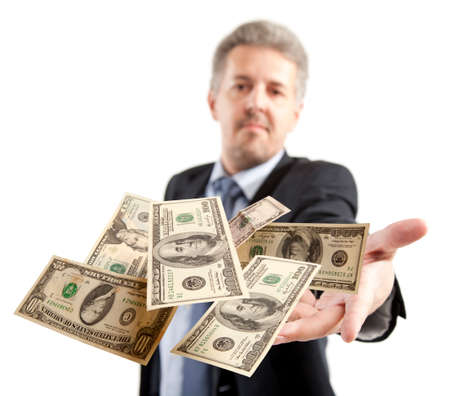 Handsome adult businessman throwing dollar photo