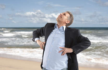 Free and relax of businessman under blue sky photo