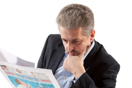 Businessman reading a newspaper on a white background photo