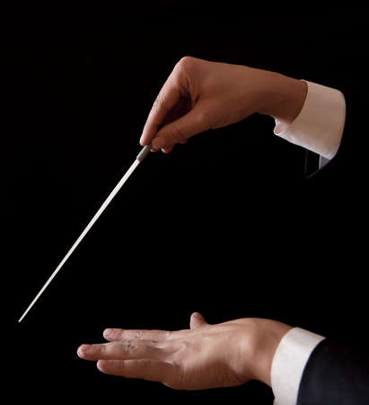 conducting: Orchestra conductor hands baton. Music male director holding stick